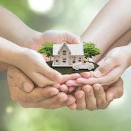 Huddled hands holding home.