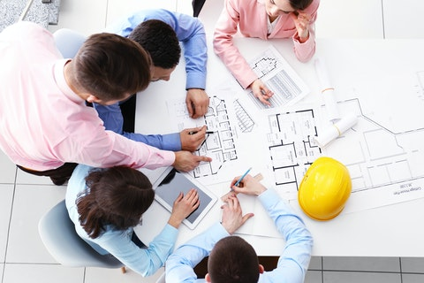 Construction meeting over plans