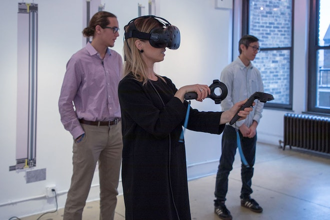 A guest exploring the latest virtual reality module developed by the Virtual Construction Lab of Schüco (VCL).